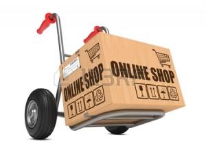 25049980-karton-mit-online-shop-slogan-auf-hand-lkw-weisser-hintergrund
